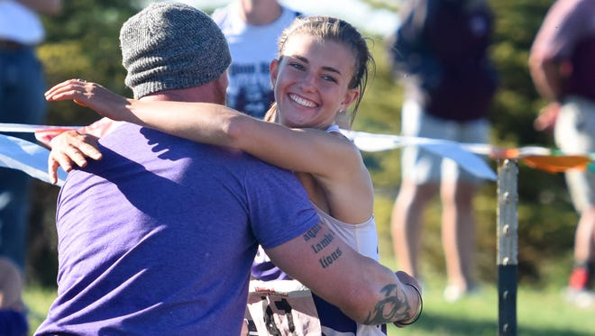 Belle Fourche's Shayla Howell hugs her coach, Joshua Schleusner, after setting the record in the triple jump during the Class A South Dakota High School State Track meet on Friday in Tea.