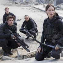 "This photo provided by Lionsgate, shows, Liam Hemsworth, front left, as Gale Hawthorne, Sam Claflin, back left, as Finnick Odair, Evan Ross, back right, as Messalla and Jennifer Lawrence as Katniss Everdeen, in ""The Hunger Games: Mockingjay - Part 2."" The movie releases in U.S. theaters on Nov. 20, 2015."