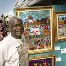 Artist Bruce Brice is photographed at the 2014 New Orleans Jazz and Heritage Festival.
