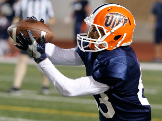 UTEP wide receiver Tre'Shon Wolf pulls in the football during drills at the SAC Friday night as UTEP took their show on the road to the east side of El Paso Friday night and held a scrimmage in front of a small crowd.