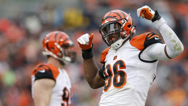 Cincinnati Bengals defensive end Carlos Dunlap (96) celebrates after a sack in the third quarter during the Week 13 NFL game between the Cincinnati Bengals and the Cleveland Browns, Sunday, Dec. 6, 2015, at FirstEnergy Stadium in Cleveland. The Bengals won 37-3.