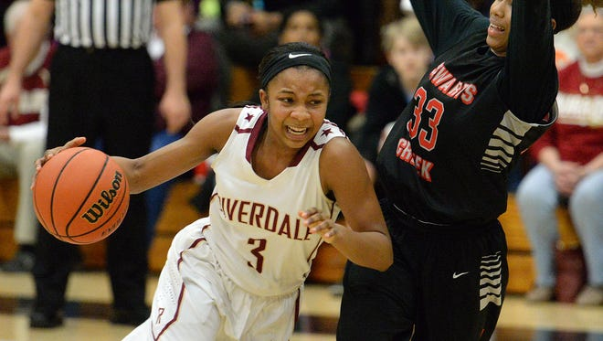 Riverdale's Anastasia Hayes drives to the basket as Stewarts Creek's Brandi Ferby defends. Riverdale beat Creek 56-48 on Monday in the District 7-AAA consolation game.