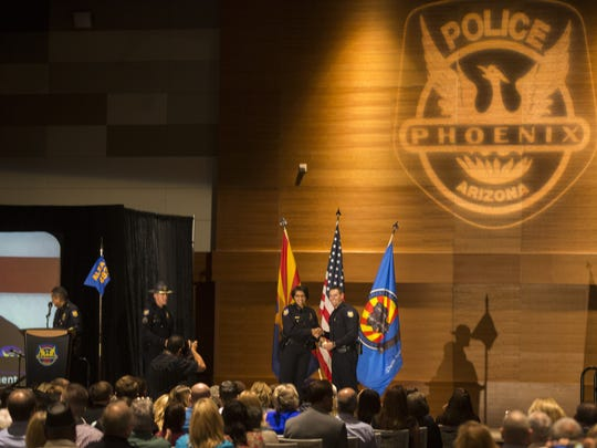 Police Chief Jeri Williams shakes the hand of new officer