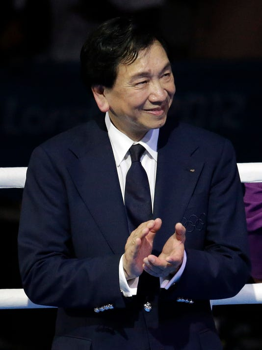 FILE - In this Aug. 9, 2012 file photo, Wu Ching-Kuo, the president of amateur boxing's governing body participates in a medal ceremony for women's middleweight 75-kg boxing at the 2012 Summer Olympics, in London.  The new professional boxing competition run by the previously amateur governing body AIBA is already showing signs of being a hit with fans, according to the organization's chief.   (AP Photo/Patrick Semansky, File)