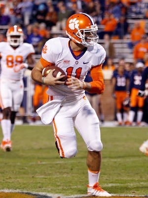 Clemson Tigers quarterback Chad Kelly (11) runs with the ball against the Virginia Cavaliers at Scott Stadium.