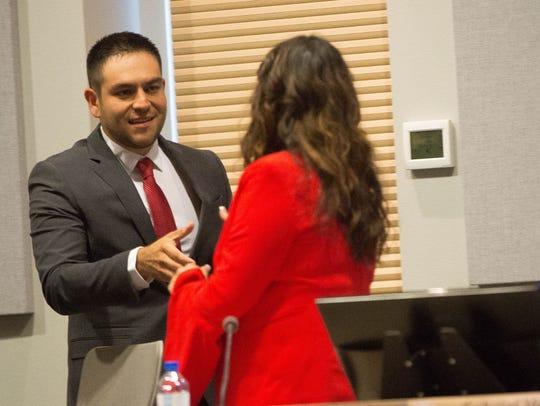 District 3 Councilor Gabriel Vasquez, left, is welcomed
