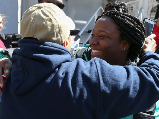 Speaker Kayla Davis (right) is hugged by her sister,