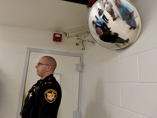 Coshocton Justice Center Jail Administrator Lt. Chip Udischas leads a tour in this Tribune file photo of the local jail for Coshocton County Commissioners and state officials. A new justice center was pursued in the past decade and still remains a top priority for the county.