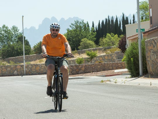 James Toth, co-owner and operator of E-Bikes of Southern New Mexico, rides a Populo Lift, a pedal-assist bicycle brand, on Monday, June 4.