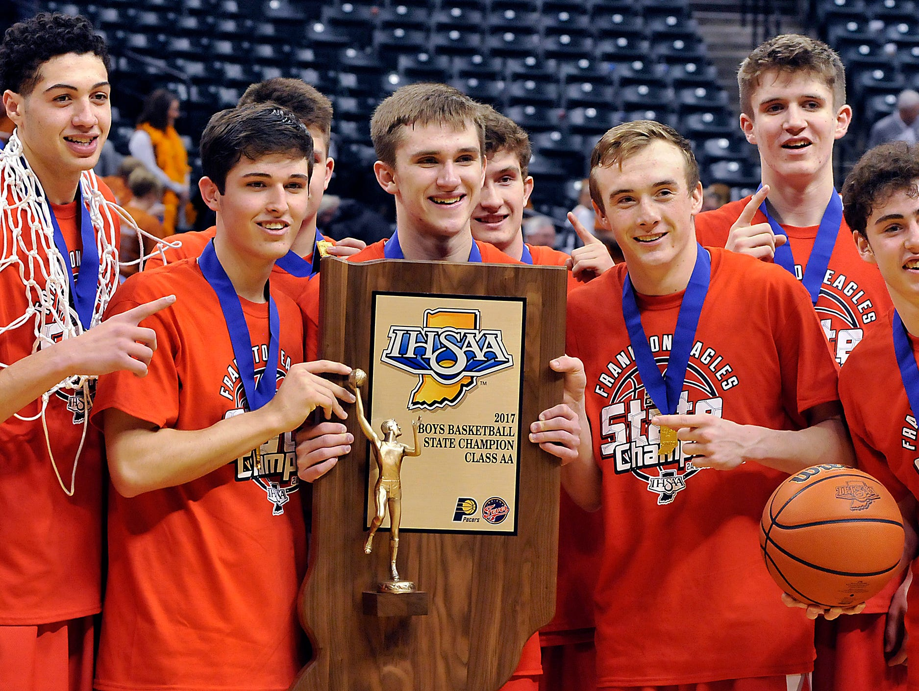 Frankton players show off their victory hardware after defeating Crawford County in the IHSAA boys' Class 2A state basketball final Saturday, March 25, 2017, in Indianapolis. (John P. Cleary/The Herald-Bulletin via AP)