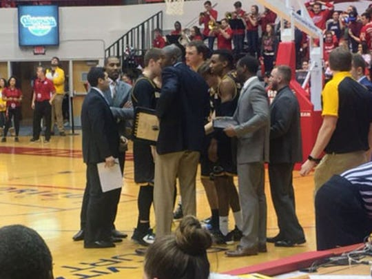 Milwaukee coach LaVall Jordan huddles up his team during UDM's 73-69 overtime loss to Milwaukee Friday at Calihan Hall.