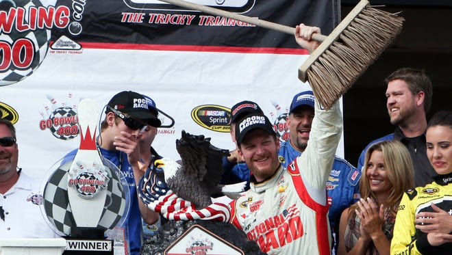 Dale Earnhardt Jr. celebrates with a broom after winning Sunday's GoBowling.com 400 and sweeping the season's two races at Pocono Raceway.