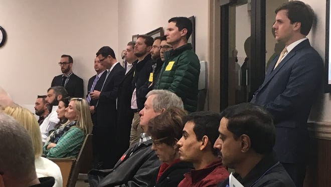 In the Franklin City Hall boardroom Tuesday night, the division in the room was in plain sight. One side of the aisle, folks wore yellow stickers, on the other, red.
