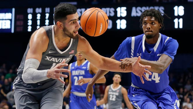 Xavier Musketeers forward Kerem Kanter (11) is fouled by Hampton Pirates forward Austin Colbert (24) as he breaks away to the basket in the second half of the NCAA men's basketball game between the Xavier Musketeers and the Hampton Pirates at the Cintas Center in Cincinnati on Monday, Nov. 20, 2017. The Musketeers took a 96-60 win over Hampton, advancing to 4-0 on the season.