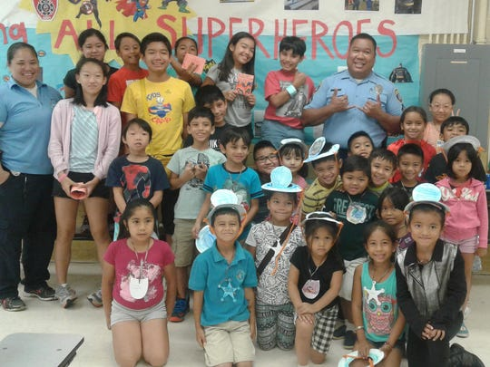 Children enrolled in the Guahan Academy Stars Summer Camp recently enjoyed a week of fun with the closing of Superhero Week. Helping to bring fun to the kids were two local superheros, Officer Suzie Santos and Officer Paul Tapao.