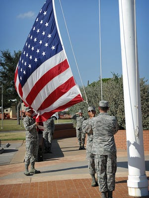 Airmen take down and collect the Stars and Stripes Monday afternoon during a special Retreat Ceremony at Sheppard Air Force Base. Brig. Gen. Ronald Jolly Sr. spoke of the date 70 years  ago when the U.S. Air Force was founded.