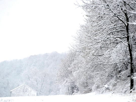 A white barn is almost hidden by the snow near Emigsville in Manchester Township Tuesday, Dec. 10, 2013. Eileen Joyce - Daily Record/Sunday News