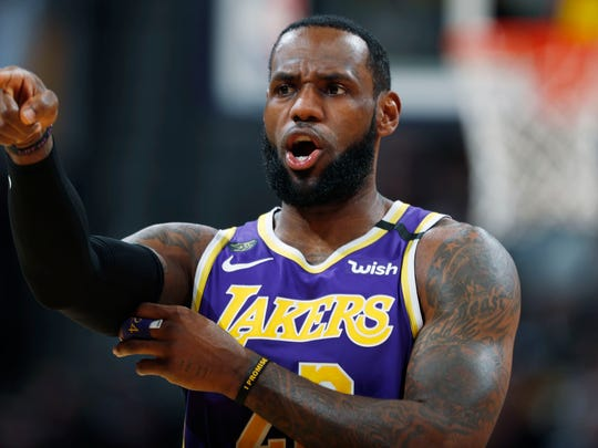 Los Angeles Lakers forward LeBron James directs teammates during the first half of the team's NBA basketball game against the Denver Nuggets on Wednesday, Feb. 12, 2020, in Denver. (AP Photo/David Zalubowski)