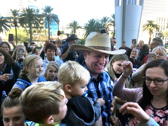 Ammon Bundy is greeted by family and friends at the