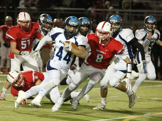 One week after rushing for six touchdowns, Waldwick/Midland Park's Sonny DiPasquale (44) threw his first TD pass of the season against Pompton Lakes on Friday night.
