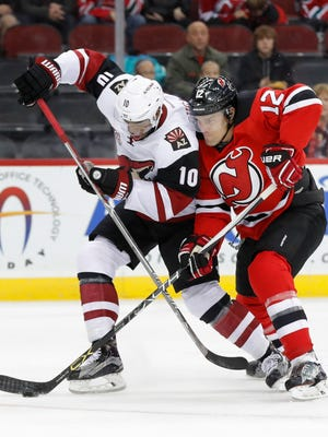 New Jersey Devils defenseman Ben Lovejoy (12) declined the invite of his former team, the Pittsburgh Penguins, to join them in their trip to the White House to celebrate their Stanley Cup championship. Lovejoy said it wasn't a political statement; the Devils had practice that day.
