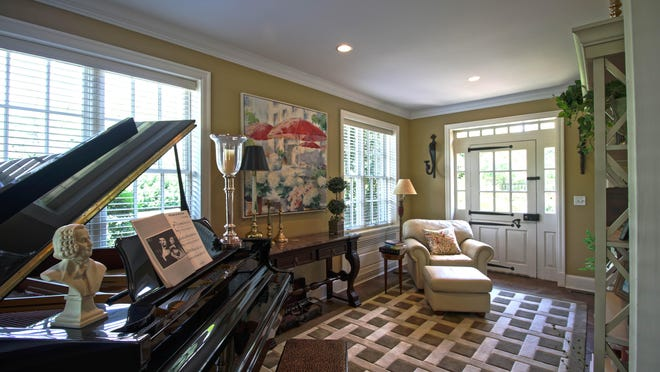 The music room is located in space off the living room that could be used for a sun room.