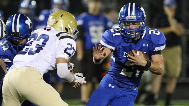 McNary's Brady Sparks runs the ball as the Celtics take on West Albany in a Greater Valley Conference game on Friday, Sept. 18, 2015.