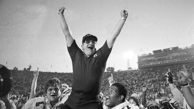 In this Jan. 1, 1981, file photo, Michigan coach Bo Schembechler is carried from the field by Glen Dwyer (71) and Ed Muransky, left, after a 23-6 win over Washington in the Rose Bowl in Pasadena, Calif. [AP Photo/File)