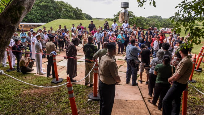 In the attendance of war survivors and others, members of the cultural group Guma' Nina'en Åcho' Latte conduct a Chamoru blessing near the entrance of the Fena Cave within the Naval Base Guam Ordnance Annex in Santa Rita, on Thursday, July 19, 2018. The visit to the cave and a memorial service was held to remember the dozens of Chamoru men and women massacred at the site by Imperial Japanese Forces during the liberation of the island in World War II.