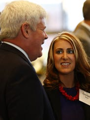 Attorney Christy Keele mingles with the crowd before