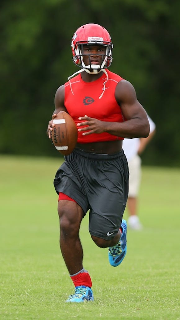 Clinton quarterback Cam Akers searches for an open
