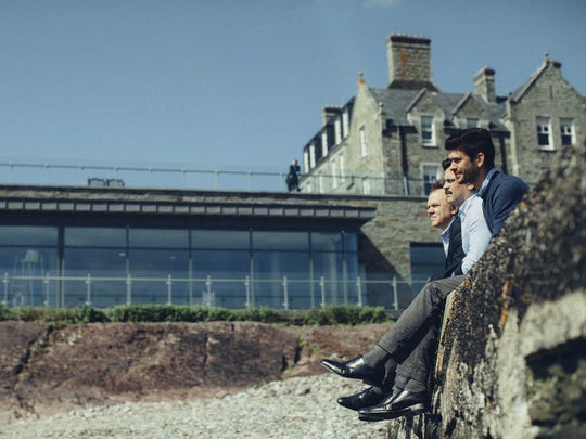 """Lisping Man (John C. Reilly, from left), David (Colin Farrell) and Limping Man (Ben Whishaw) ponder their fates in """"The Lobster."""""""
