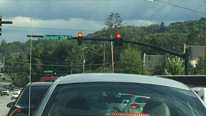 The lights along Hendersonville Road have been out of sync recently after work from a nearby sidewalk project damaged equipment.