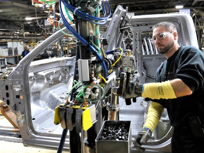 Tim Marshall of Southgate attaches the driver's door on the cab of this 2014 Ram 1500 during the Warren Truck Assembly Media Open House in Warren, Thursday, Sept.25, 2014. According to officials, this 76-year-old United Auto Workers plant is making 38,000 more vehicles this year.