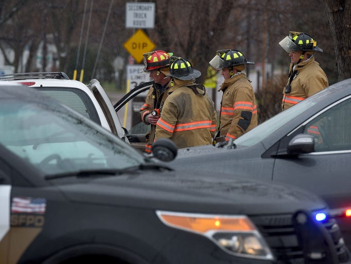 Emergency personnel respond to an accident at E. 17th