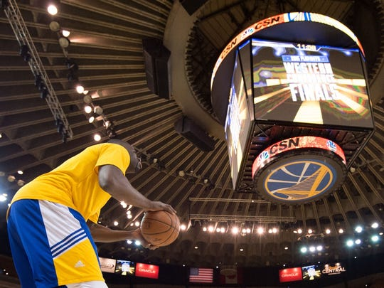 Draymond Green takes practice shots at Oracle Arena.