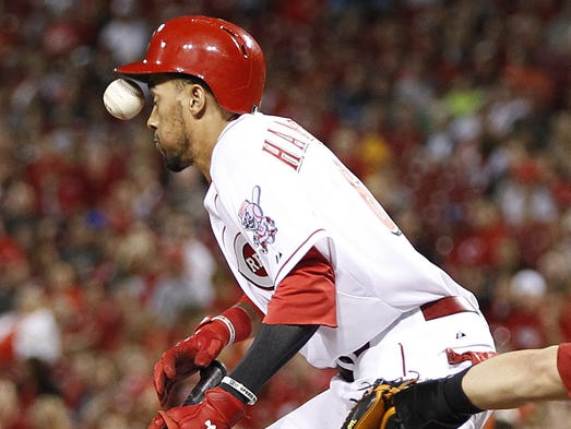 Cincinnati Reds center fielder Billy Hamilton (6) gets hit in the face on a foul ball bunt during the eleventh inning