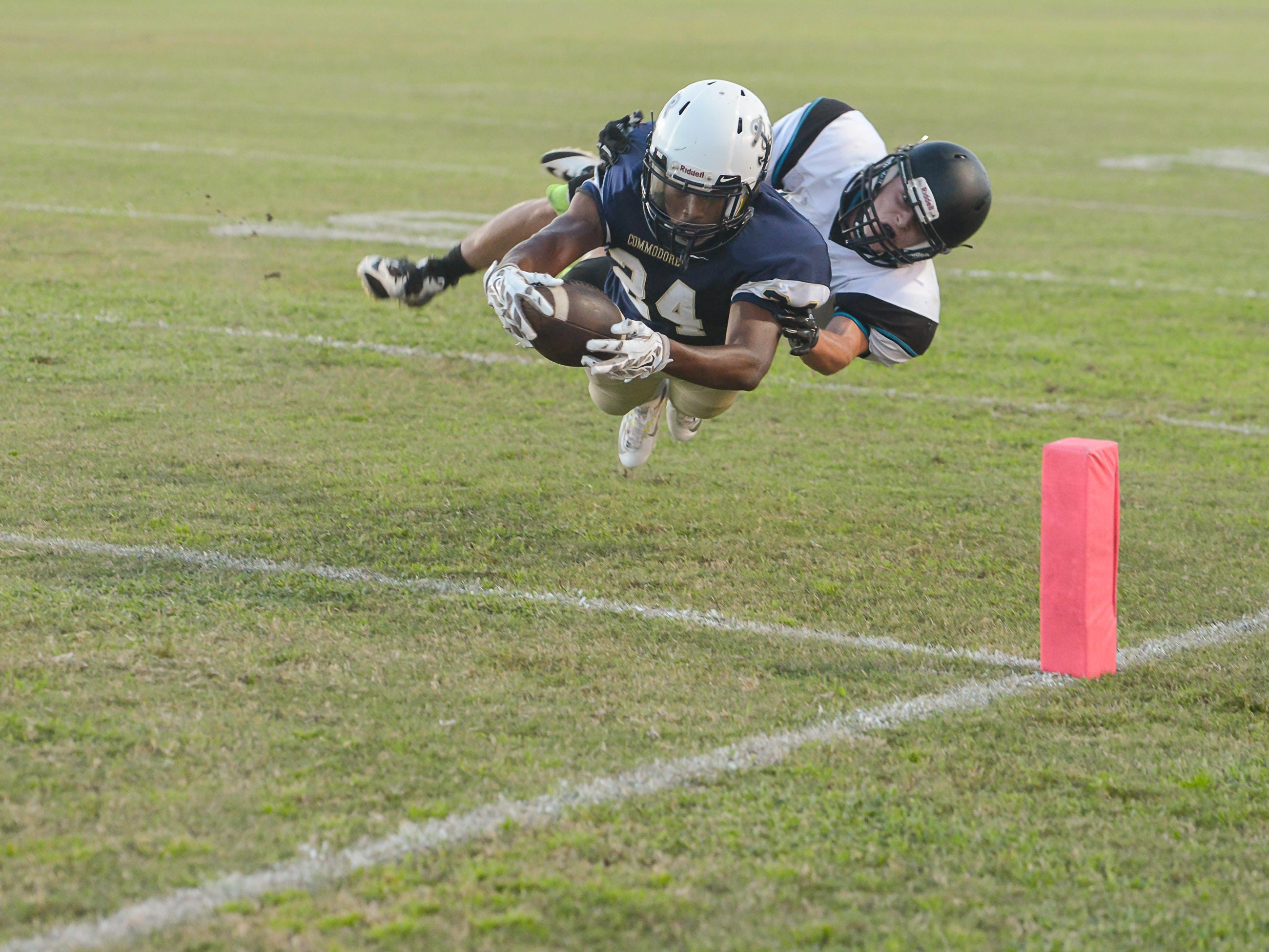 Jalen Shelton scores for Eau Gallie High during the game against Bayside. (Photo by Amanda Stratford, for FLORIDA TODAY)