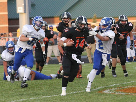 Gibsonburg's Ryan Clark tries to ward off a Tiffin Calvert defender.