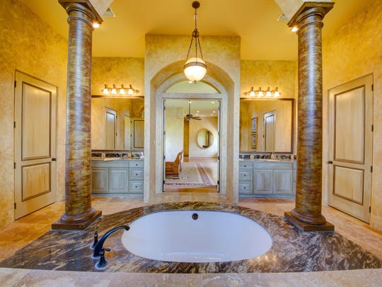 Marble columns surround the mater bath and tub.