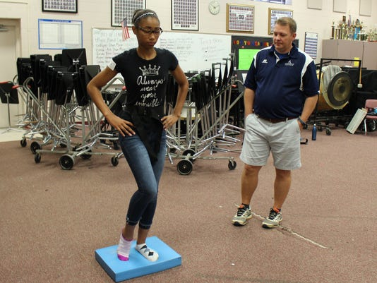636360162657469770-Navarre-High-School-freshman-Mackenzie-Green-during-balance-test-with-Bob-Land-ATC-2.JPG