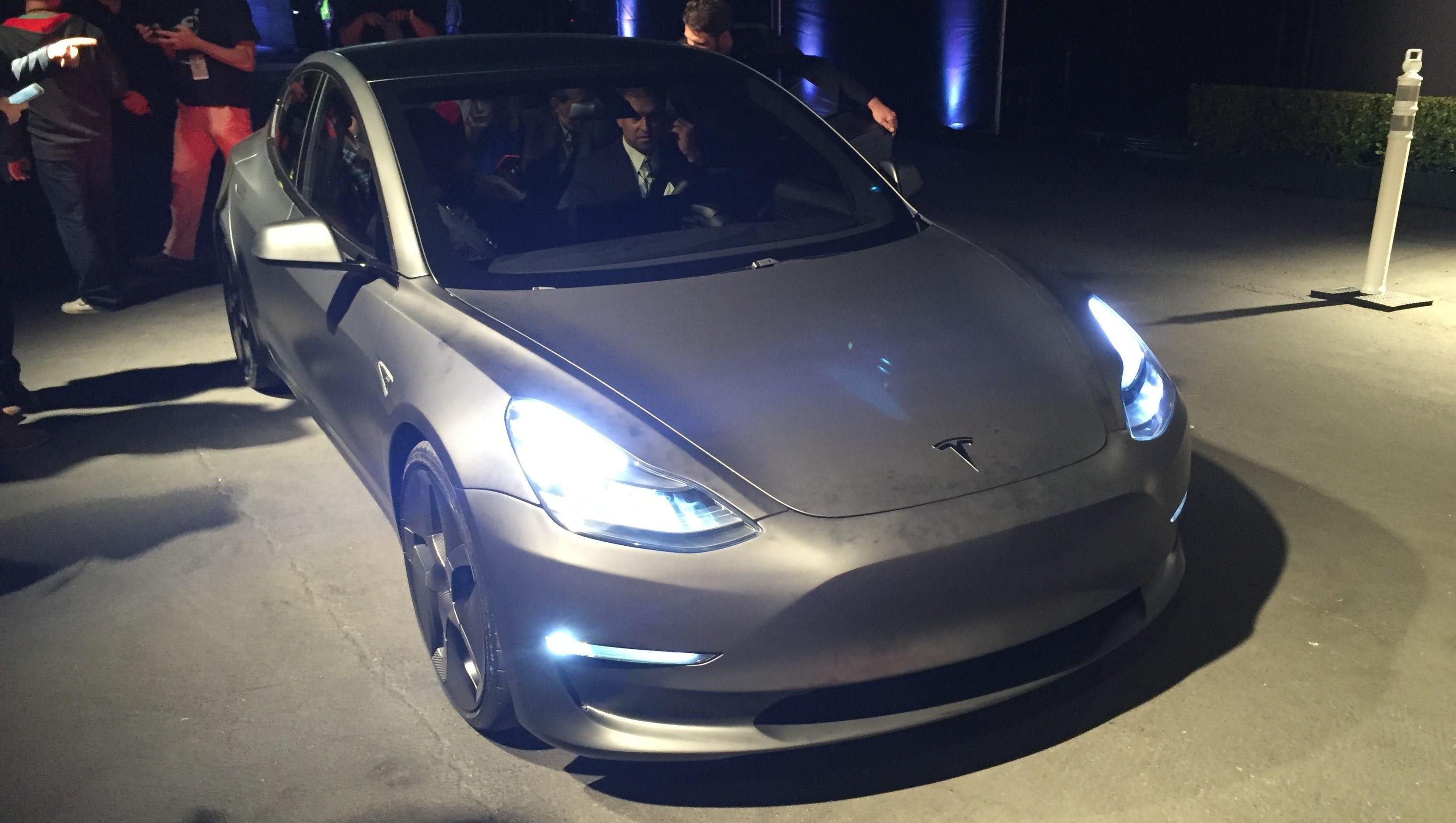 Tesla unveils its model 3 sedan as pre orders top 198 000 for Tesla motors careers login