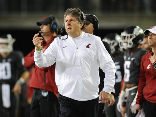 Washington State coach Mike Leach stands on the sideline