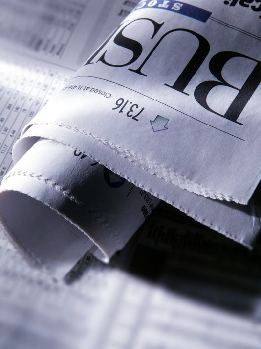 Folded business section of newspaper in early morning light
