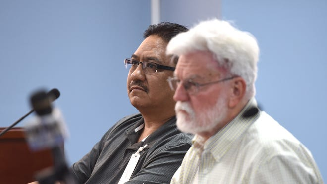 In this June 1 file photo, Mark Charfauros, left, who was demoted and fired from the Guam Police Department, attends a Civil Service Commission meeting with attorney Jeff Cook.