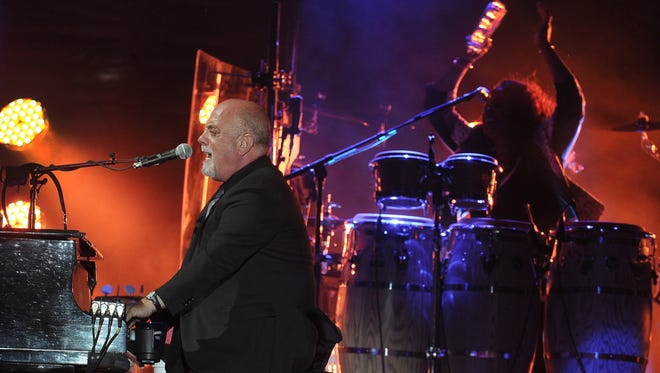 Billy Joel performs at the  Bonnaroo Music and Arts Festival on Sunday.