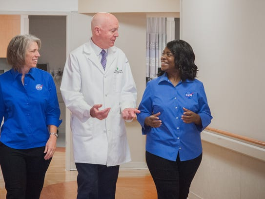 NASA scientist Tara Melaine Ruttley (left) and Lesa Spivey, Strategic Communications & Partnerships Lead at NASA Johnson Space Center, tour Christiana Hospital with Brian Galinat. M.D., MBA, chair of Orthopedic Surgery and physician leader of Musculoskeletal Health for Christiana Care.