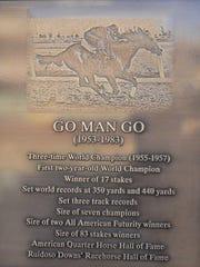 A bronze plaque that explains Go Man Go's historic