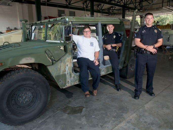 Gulf Breeze Firefight Frank Brooks, left, and Police Officers Travis White, center and Kevin Skelton, right, and Travis White, right, used a newly acquired Humvee to rescue number of people in swamped areas of the city. The Gulf Breeze Fire Department took delivery of the surplus military hardware just days before late Aprilâ??s flood.