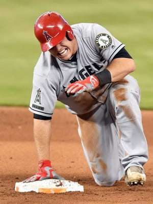 Mike Trout (27) injures his hand after sliding into second base in the fifth inning at Marlins Park.